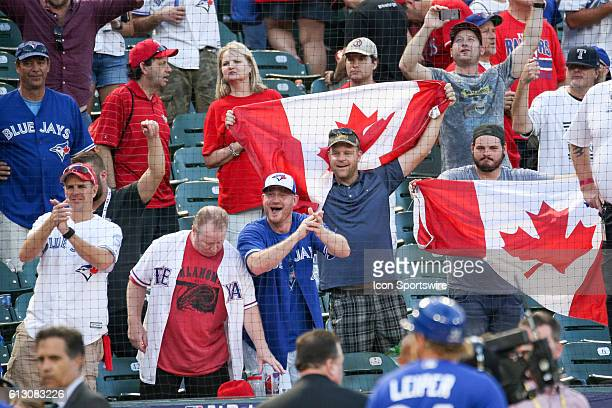 Toronto Blue Jays fans cheer after game 1 of the ALDS between the Toronto Blue Jays and Texas Rangers at Globe Life Park in Arlington TX Toronto...