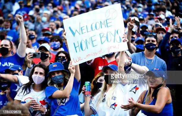 Toronto Blue Jays fans cheer as the team makes their way onto the field for their first home game in Toronto this season prior to a MLB game against...