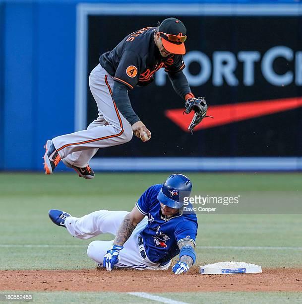 TORONTO ON Toronto Blue Jays first baseman Edwin Encarnacion grounds into a fielder choice as Jays third baseman Brett Lawrie breaks up the double...