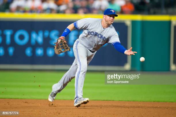 Toronto Blue Jays first baseman Justin Smoak tosses the ball to Toronto Blue Jays relief pitcher JP Howell for the out in the eighth inning of a MLB...