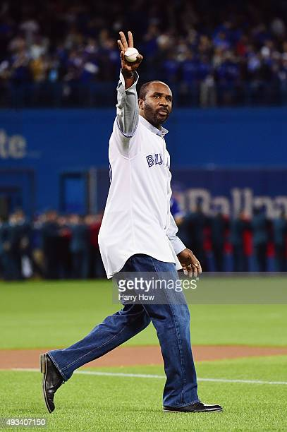 Toronto Blue Jays former player Devon White is introduced before throwing out the ceremonial first pitch prior to game three of the American League...