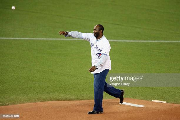 Toronto Blue Jays former player Devon White throws out the ceremonial first pitch prior to game three of the American League Championship Series...