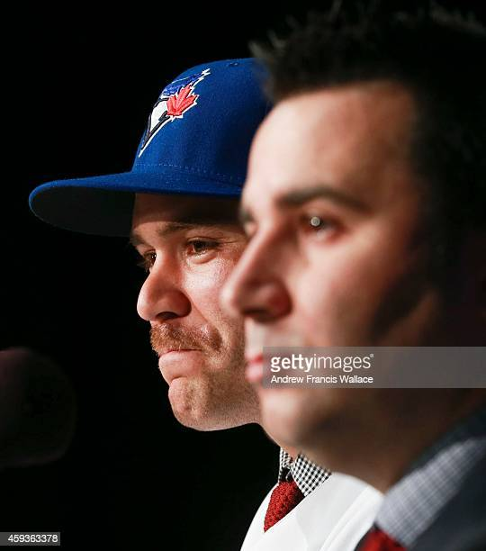 TORONTO ON NOVEMBER 20 Toronto Blue Jays general manager Alex Anthopoulos with newly acquired catcher Russell Martin at press conference atbthe...