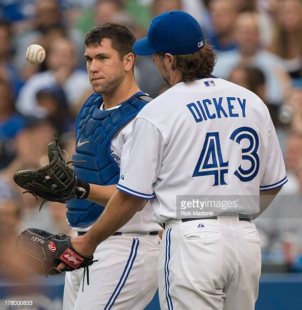 Toronto Blue Jays host New York Yankees at Roger's Centre in Toronto, onAugust 26, 2013. Catcher Josh Thole flips the ball back to pitcher RA Dickey...