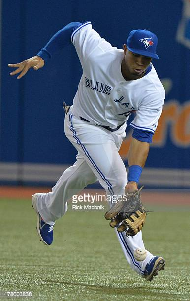 TORONTO ON AUGUST 26 Toronto Blue Jays host New York Yankees at Roger's Centre in Toronto onAugust 26 2013 Jays RF Moises Sierra tries to catch up to...