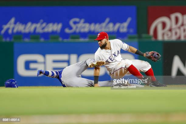 Toronto Blue Jays infielder Ryan Goins is safe at second after colliding with Texas Rangers second baseman Rougned Odor during the MLB game between...