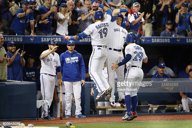 TORONTO ON SEPTEMBER 12 Toronto Blue Jays Jose Bautista celebrates with Troy Tulowitzki after hitting a two run homer in the sixth inning as the...