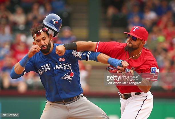 Toronto Blue Jays Jose Bautista gets hit by Texas Rangers second baseman Rougned Odor after Bautista slid into second in the 8th inning at Globe Life...