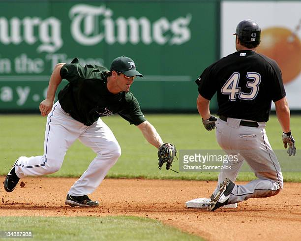 Toronto Blue Jays Kevin Barker slides in safely at second base beating the tag from Tampa Bay Devil Rays infielder Nick Green at Progress Energy Park...