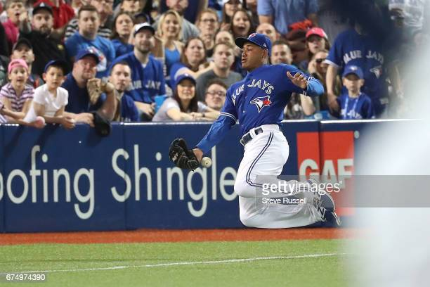 TORONTO APRIL 29 Toronto Blue Jays left fielder Ezequiel Carrera nearly catches a ball in foul territory as the Toronto Blue Jays beat the Tampa Bay...