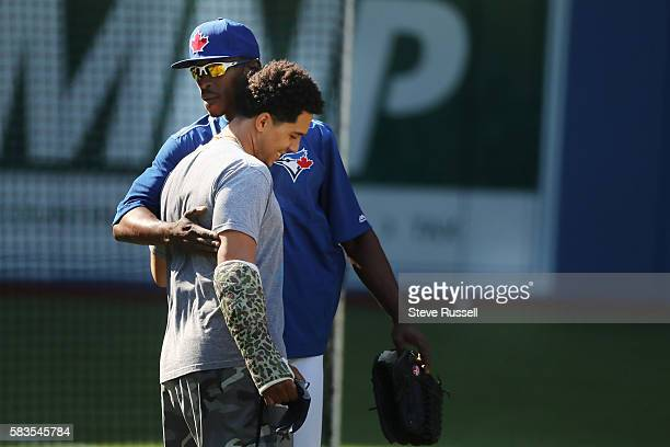 TORONTO ON JULY 26 Toronto Blue Jays left fielder Melvin Upton Jr greets a former teammate He watched the game from the visitors dugout last night...