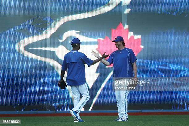 TORONTO ON JULY 26 Toronto Blue Jays left fielder Melvin Upton Jr greets Jason Grilli He watched the game from the visitors dugout last night today...