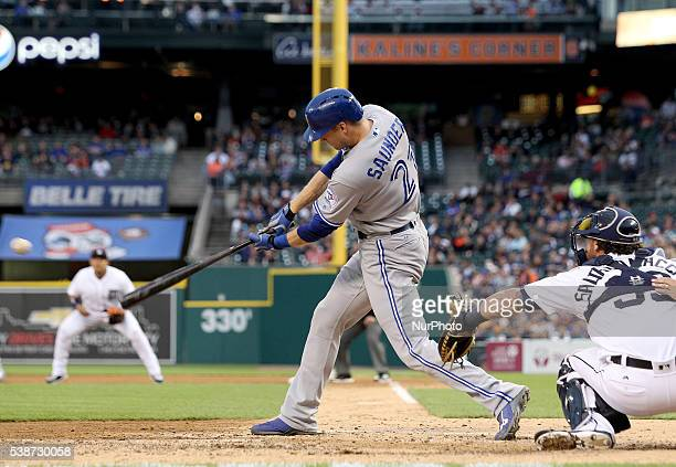Toronto Blue Jays left fielder Michael Saunders singles in the sixth inning of a baseball game against the Detroit Tigers in Detroit Michigan USA on...