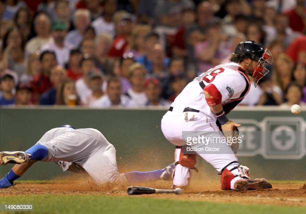 Toronto Blue Jays left fielder Rajai Davis slides safely home before the throw to Boston Red Sox catcher Jarrod Saltalamacchia during the seventh...