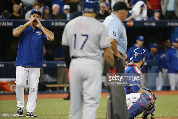 Toronto Blue Jays manager John Gibbons disputes a call made on the field by the umpiring crew that allowed Rougned Odor to score from third base on a...