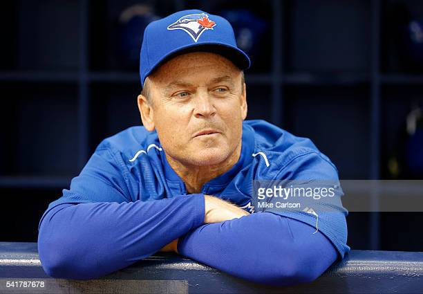 Toronto Blue Jays manager John Gibbons looks on from the dugout before the Opening Day game against the Tampa Bay Rays at Tropicana Field on Sunday...