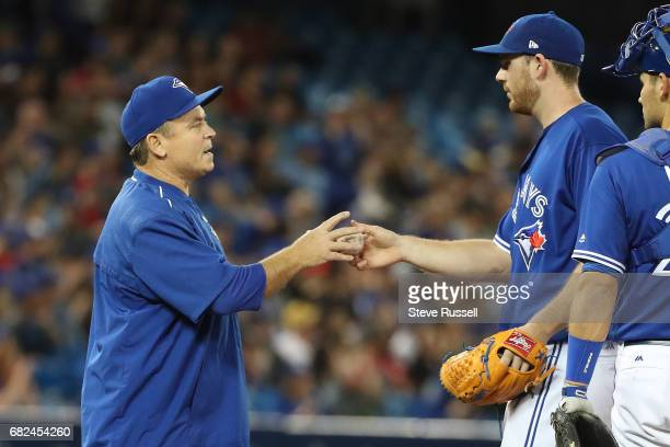 TORONTO MAY 12 Toronto Blue Jays manager John Gibbons takes the ball from Joe Biagini in the sixth inning as the Toronto Blue Jays play the Seattle...