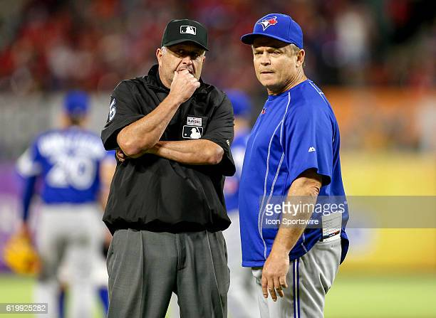 Toronto Blue Jays manager John Gibbons talks with second base Umpire Dale Scott during the MLB game between the Toronto Blue Jays and Texas Rangers...