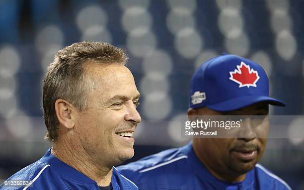 TORONTO ON OCTOBER 8 Toronto Blue Jays manager John Gibbons walks with Toronto Blue Jays bench coach DeMarlo Hale as Toronto Blue Jays and Texas...