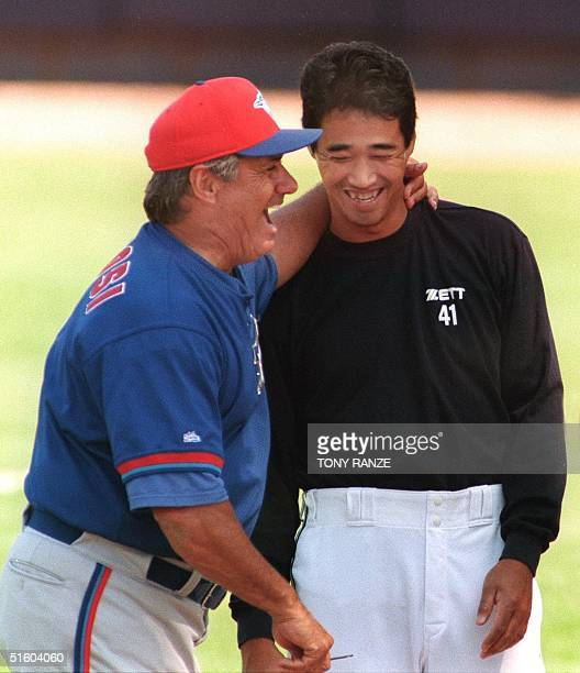 Toronto Blue Jays new manager Jim Fregosi shares a joke with Detroit Tigers pitcher Masao Kida of Japan before the start of the spring training game...