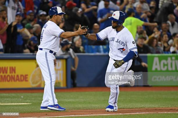 Toronto Blue Jays Outfield Teoscar Hernandez is celebrates with Third base coach Luis Rivera after a sixth inning solo hone run during the regular...