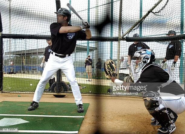 Toronto Blue Jays outfielder Frank Catalanotto in the battling cage with catcher Bengie Molina at a spring training workout February 22 2006 in...