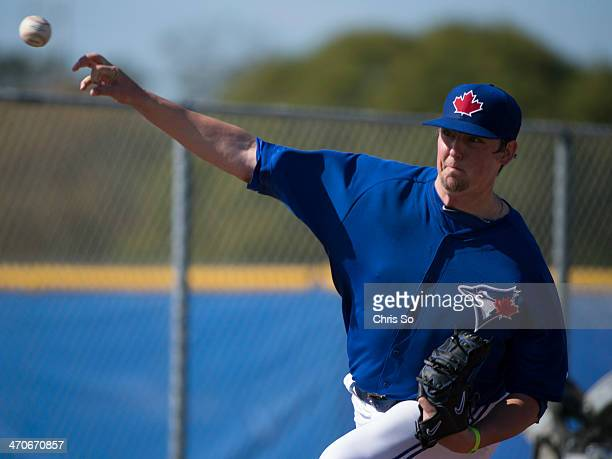 Toronto Blue Jays pitcher Deck McGuire throws a pitch during pitching drills at the Bobby Mattick Training Center in Dunedin Florida