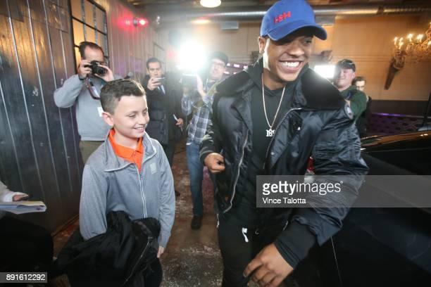 Toronto Blue Jays pitcher Marcus Stroman and Antonio Albino 9 year old SickKids Ambassador prepare to enter the car at the launch of Lyft the newest...