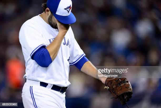 Toronto Blue Jays Pitcher Mike Bolsinger exits the field dejected during the MLB regular season game between the Toronto Blue Jays and the Atlanta...