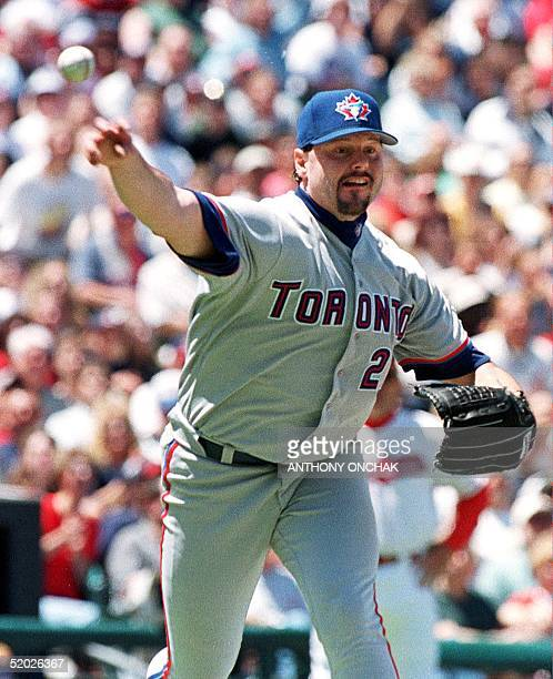 Toronto Blue Jays' pitcher Roger Clemens throws to first after Cleveland Indians' batter Travis Fryman hit a short chopper to the mound during the...
