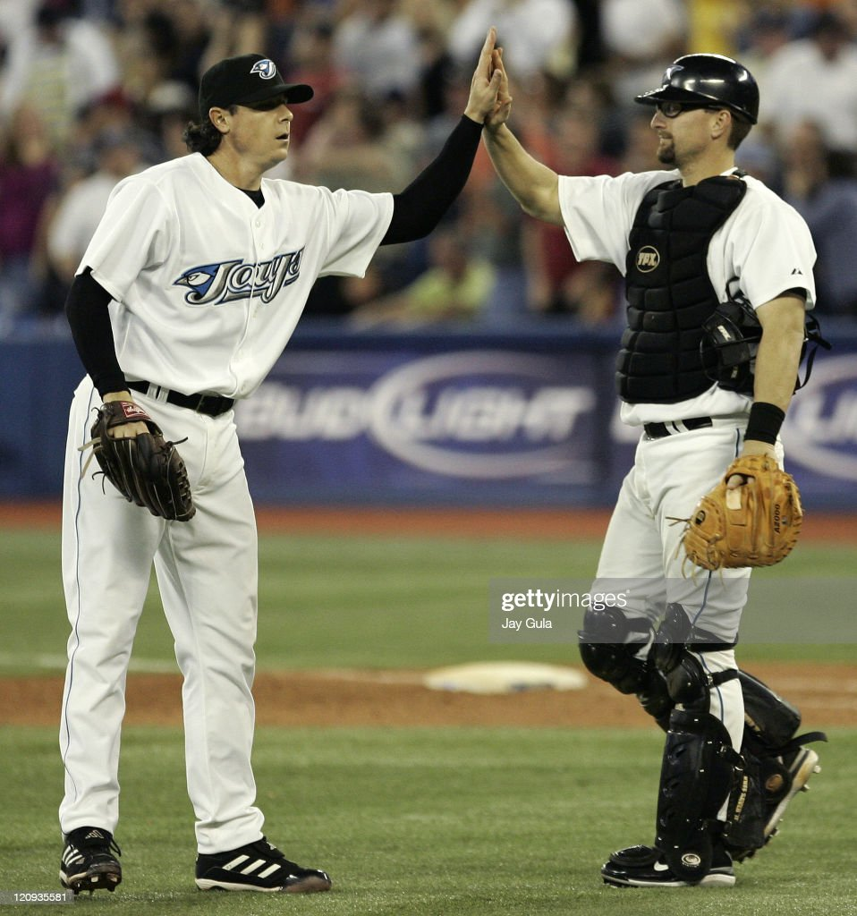 Toronto Blue Jays pitcher Scott Downs and catcher Jason Phillips high five after a 7-2 win vs the New York Yankees at Rogers Centre in Toronto, Canada on May 28, 2007.