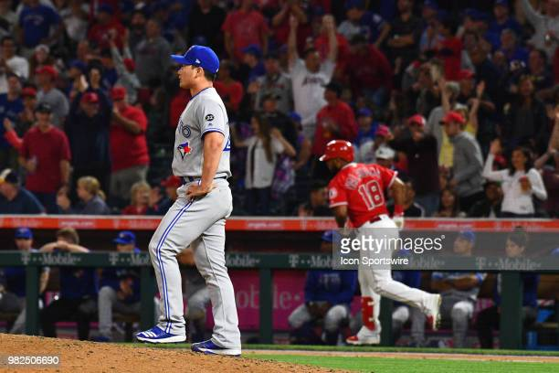 Toronto Blue Jays pitcher Seunghwan Oh watches Los Angeles Angels infielder Luis Valbuena home run during a MLB game between the Toronto Blue Jays...