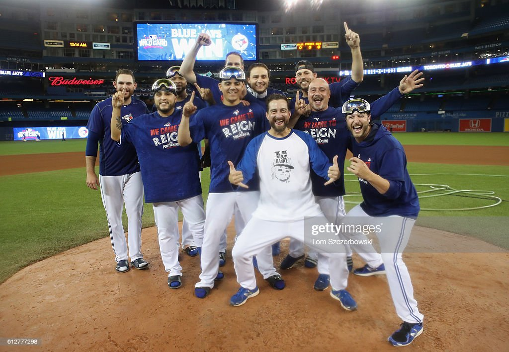 Toronto Blue Jays pitchers and coaches celebrate after defeating the Baltimore Orioles 5-2 in the eleventh inning to win the American League Wild Card game at Rogers Centre on October 4, 2016 in Toronto, Canada.