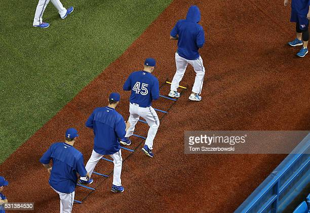 Toronto Blue Jays pitchers do agility ladder drills before the start of MLB game action against the Texas Rangers on May 5 2016 at Rogers Centre in...