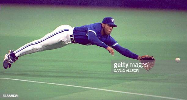 Toronto Blue Jays' player Roberto Alomar dives and misses a hit single by California Angels player Chili Davis in the second inning 30 April at the...