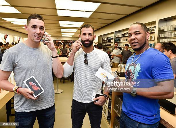 Toronto Blue Jays players Aaron Sanchez Jose Bautista and Edwin Encarnacion stop by Apple Store Eaton Centre in Toronto for new iPhone 6s and iPhone...