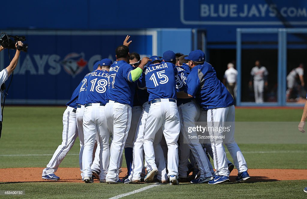 Toronto Blue Jays players celebrate their victory in the tenth inning during MLB game action against the Detroit Tigers on August 9, 2014 at Rogers Centre in Toronto, Ontario, Canada.