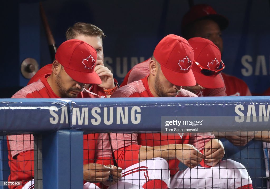 Toronto Blue Jays react to their 15-1 loss as they look on from the top step of the dugout during MLB game action against the Boston Red Sox at Rogers Centre on July 2, 2017 in Toronto, Canada.