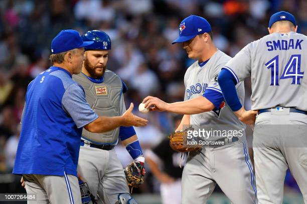 Toronto Blue Jays relief pitcher Aaron Loup hands the ball over to Toronto Blue Jays manager John Gibbons after being relieved against the Chicago...