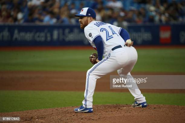 TORONTO ON JUNE 19 Toronto Blue Jays relief pitcher Danny Barnes winds up as the Toronto Blue Jays lose to the Atlanta Braves 114 at Rogers Centre in...
