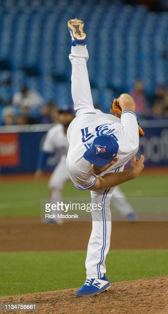 Toronto Blue Jays relief pitcher Joe Biagini with a vertical follow through on his pitch Toronto Blue Jays Vs Baltimore Orioles in MLB season play at...