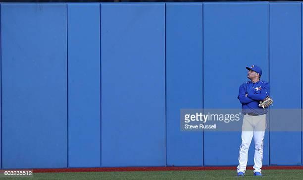 TORONTO ON SEPTEMBER 12 Toronto Blue Jays relief pitcher Roberto Osuna watches batting practice as the Toronto Blue Jays play the Tampa Bay Rays in...