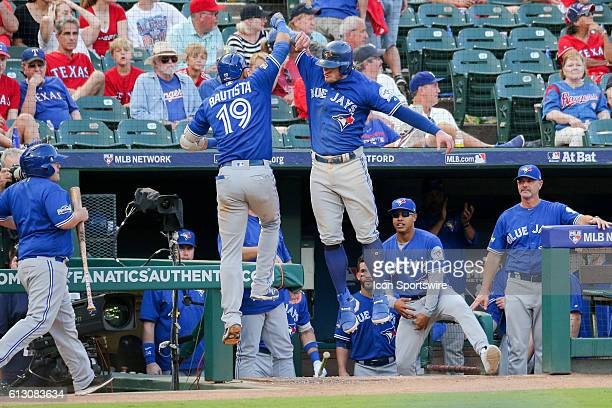 Toronto Blue Jays right fielder Jose Bautista celebrates his 3 run home run with third baseman Josh Donaldson during game 1 of the ALDS between the...