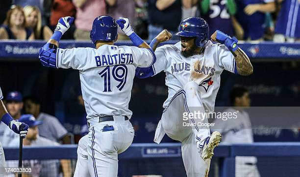 TORONTO ON Toronto Blue Jays right fielder Jose Bautista celebrates his home run with shortstop Jose Reyes who scored ahead of him on his two run HR...