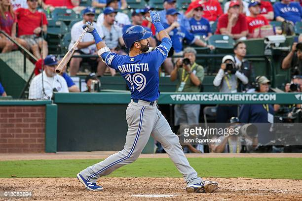Toronto Blue Jays right fielder Jose Bautista hits a 3run home run during game 1 of the ALDS between the Toronto Blue Jays and Texas Rangers at Globe...