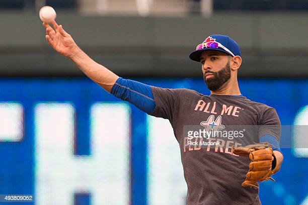 Toronto Blue Jays right fielder Jose Bautista throws the ball back to the batting cage as he takes some infield grounders Toronto Blue Jays workout...