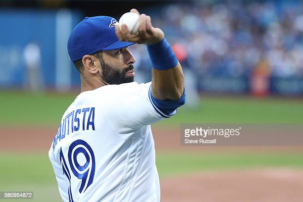 TORONTO ON JULY 25 Toronto Blue Jays right fielder Jose Bautista warms up before the game as the Toronto Blue Jays play the San Diego Padres at the...