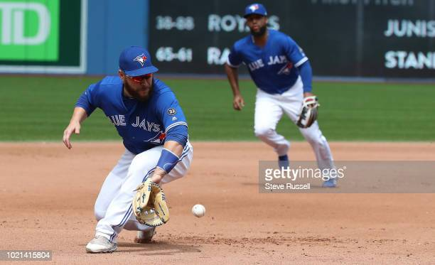 TORONTO ON AUGUST 22 Toronto Blue Jays Russell Martin makes a play on a Baltimore Orioles shortstop Tim Beckham grounder as the Toronto Blue Jays...