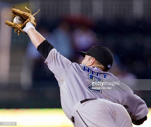 Toronto Blue Jays second baseman Aaron Hill spears a line drive off the bat of Kansas City Royals' Mitch Maier in the fifth inning at Kauffman...