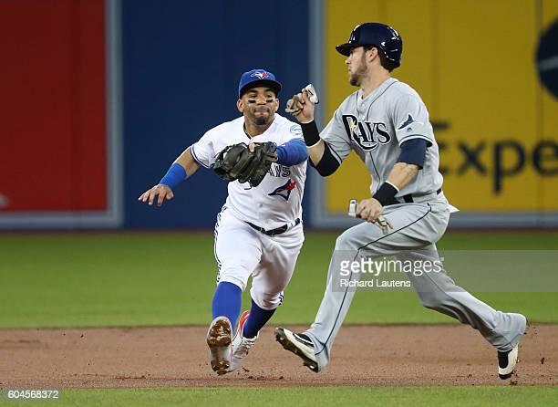 TORONTO ON SEPTEMBER 13 Toronto Blue Jays second baseman Devon Travis takes out Tampa Bay Rays left fielder Nick Franklin off a hit by Tampa Bay Rays...